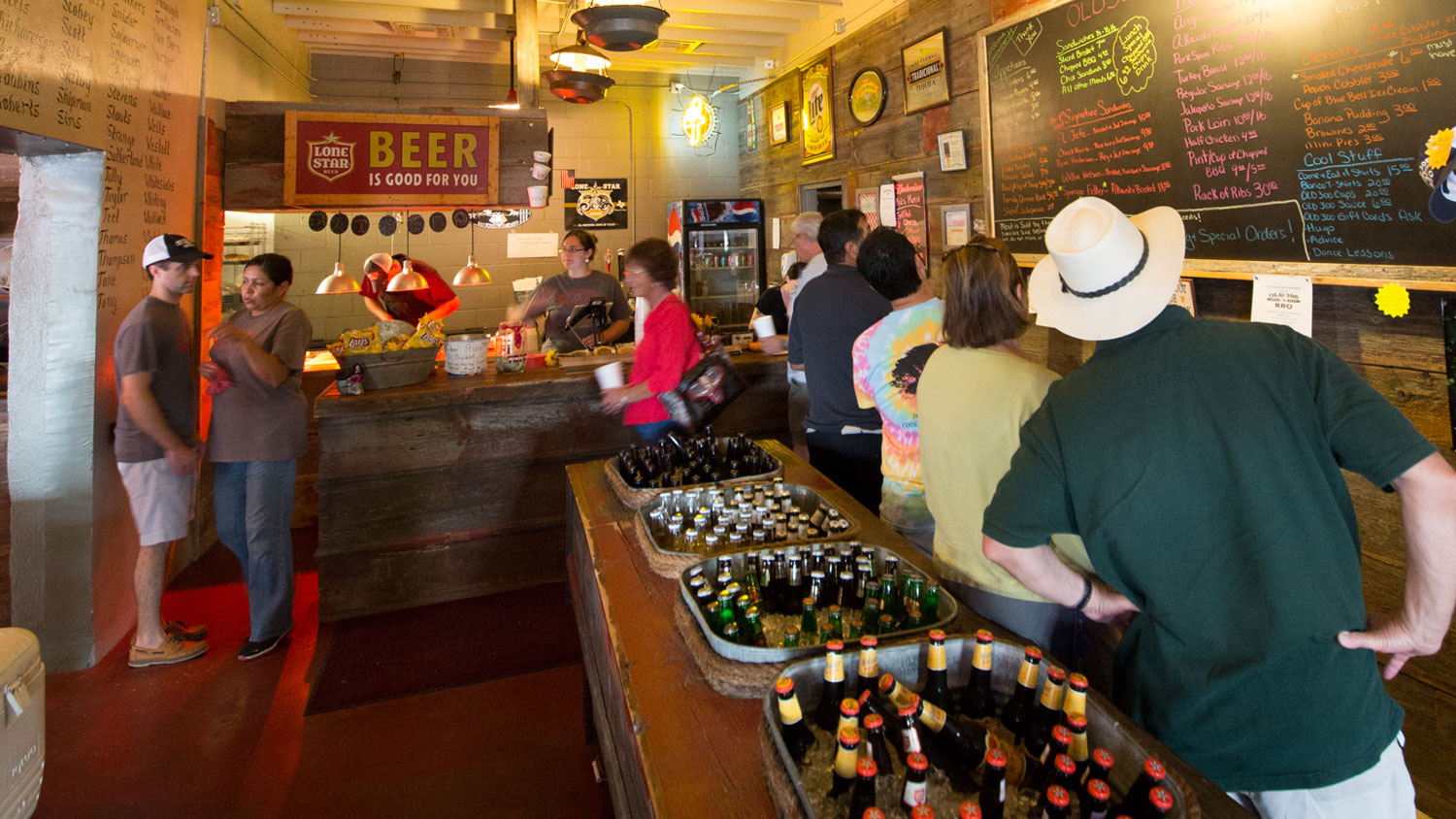 Customers view the menu as they wait in line to order at Old 300 BBQ