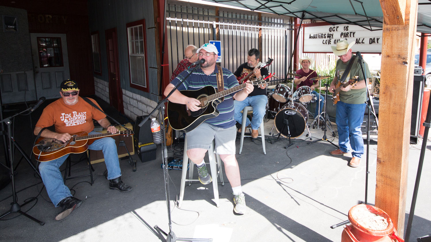 A live banc performs on the front porch at Old 300 BBQ