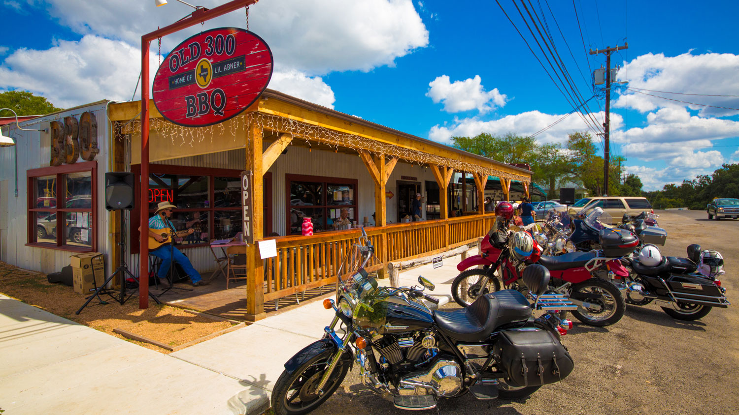 An exterior view of Old 300 BBQ with motorcycles parked out front