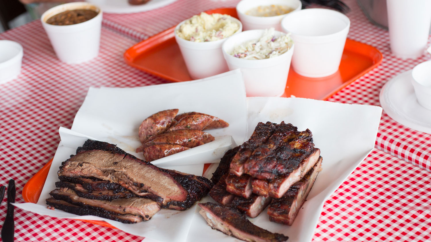 Brisket, sausage and ribs with sides, ready for eating, at Old 300 BBQ