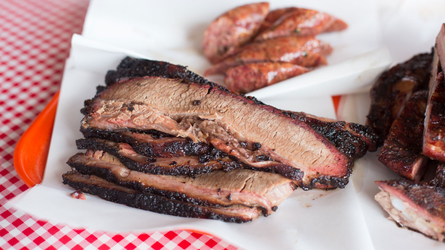 Sliced brisket and sausage from Old 300 BBQ