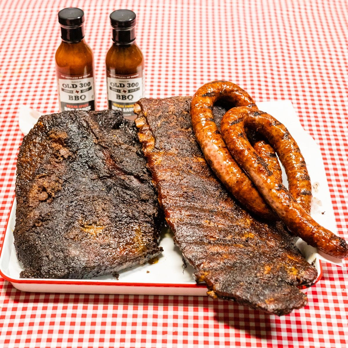 angus-brisket-ribs-and-sausages-trio